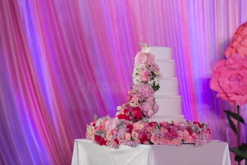 Wedding cake. Tiered wedding cake at indoor wedding party royalty free stock photo