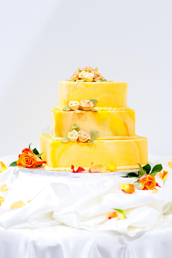 Wedding cake in white, green and rose. With sugared flowers for eating. Beautiful sweet dessert for a party stock image