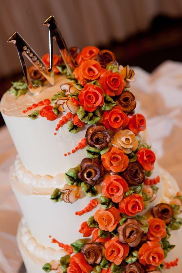 Wedding cake. White wedding cake at reception royalty free stock photo