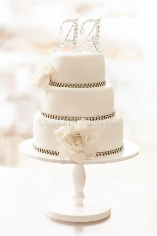 Wedding Cake. White three tier wedding cake with AA initials on top stock photos