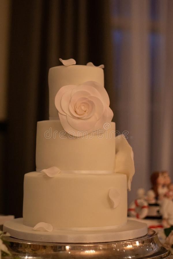Wedding Cake. White Wedding Cake with flowers and petals stock image