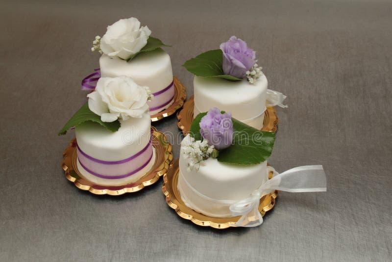 Wedding cakes. Marzipan wedding cakes with fresh flowers royalty free stock photos