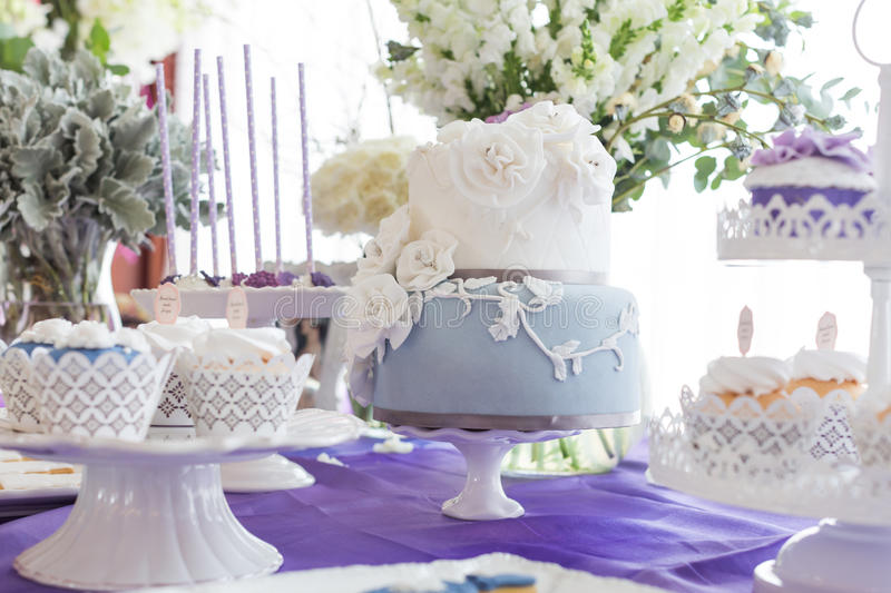 Wedding cakes. Tiered wedding cakes at indoor wedding party stock images