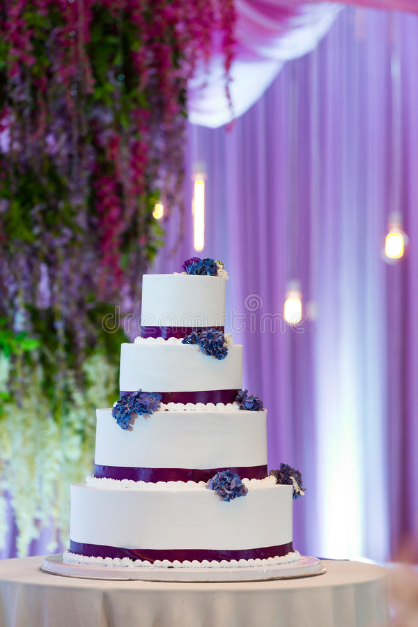 Wedding cakes. Tiered wedding cakes at indoor wedding party stock photo