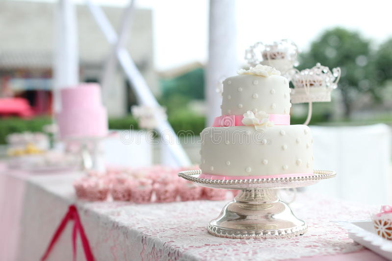 Wedding cakes. Tiered wedding cakes at outdoor wedding party stock photo