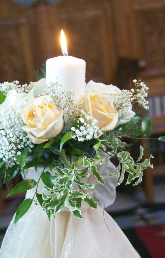 Wedding candle. With flowers and ribbon royalty free stock photos