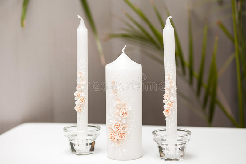 Wedding candlestick with flower decoration before royalty free stock image