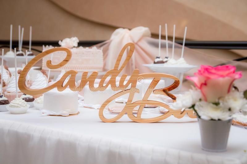 Wedding candy bar. wooden inscription on the table royalty free stock photos