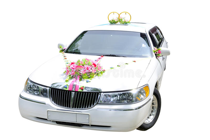 Wedding car. The white wedding car decorated with flowers on a white background stock photos
