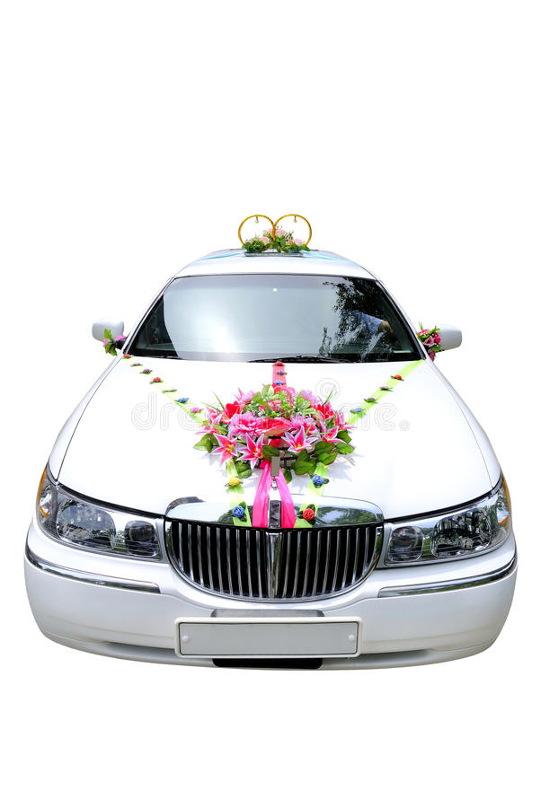 Wedding car. The white wedding car decorated with flowers on a white background royalty free stock image