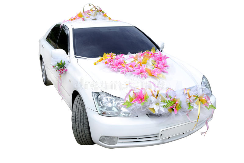 Wedding car. The white wedding car decorated with flowers on a white background stock images