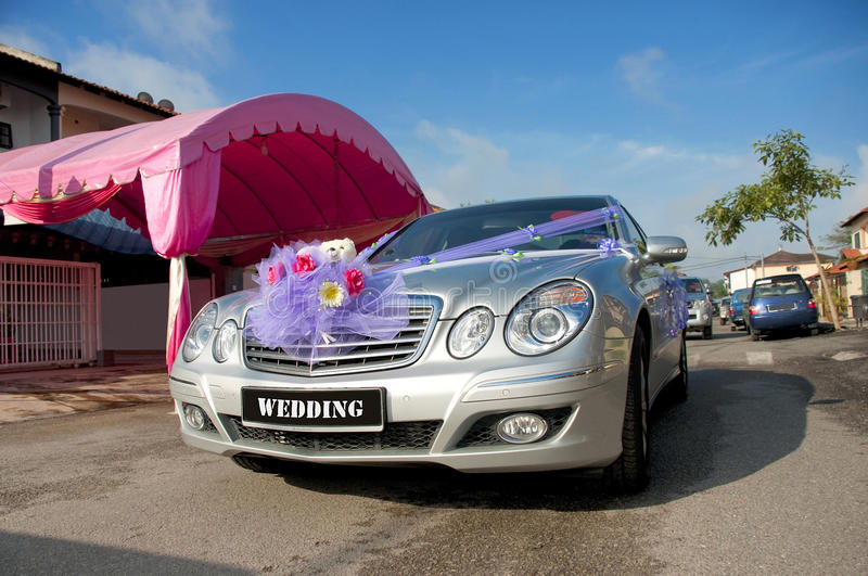 Wedding car. A silver decorated car for a wedding ceremony stock images