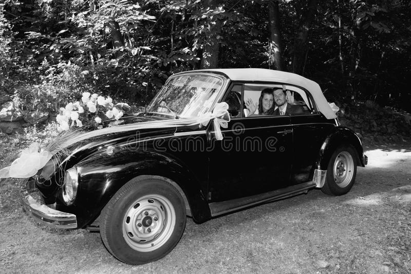 Wedding car. Wedding pictures, the couple on the wedding car royalty free stock photo