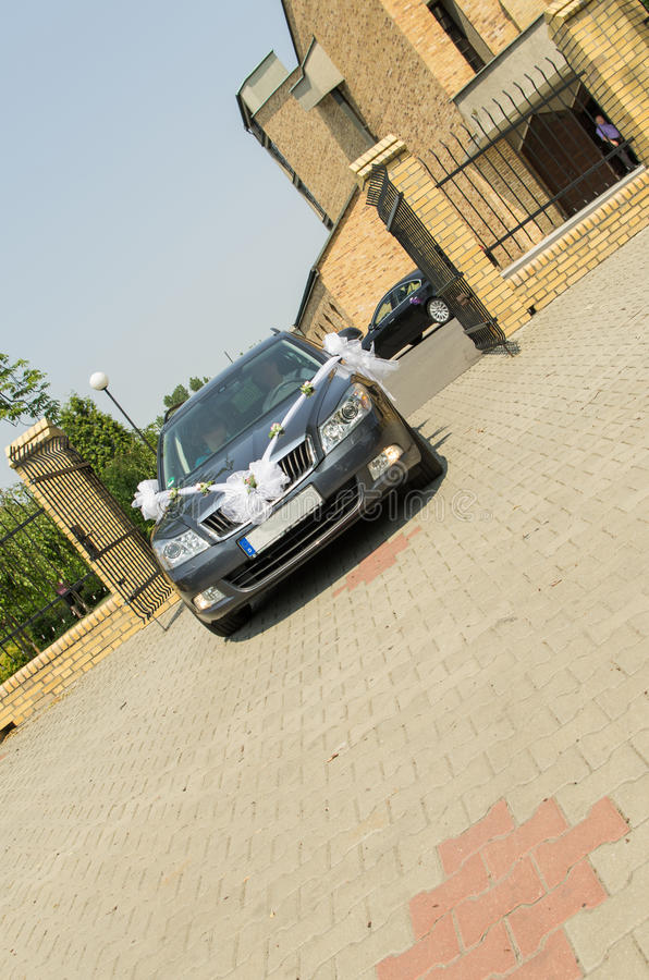 Wedding car. At the background view of modern church royalty free stock photos
