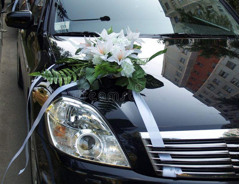 Wedding car. Right side of a black car decorated for wedding occasion stock image