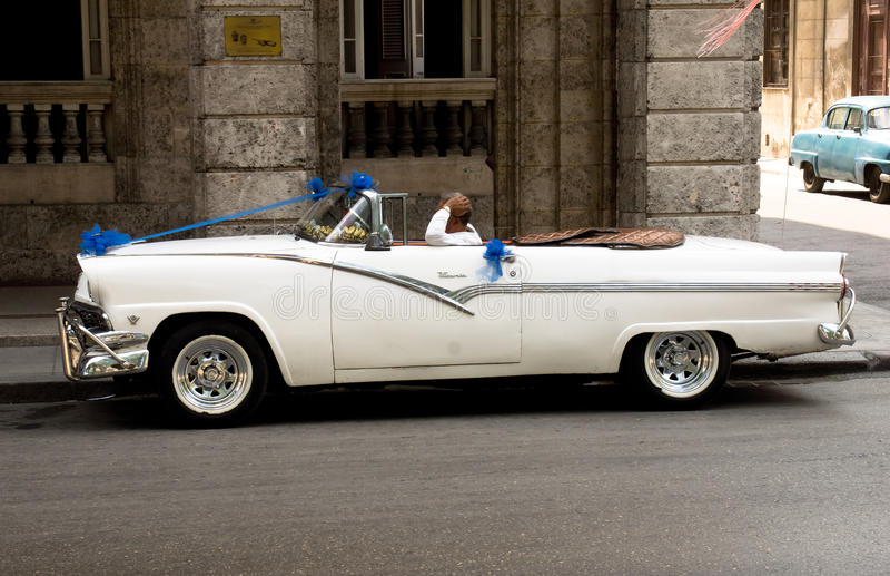 Wedding car & driver, Havana, Cuba royalty free stock photos