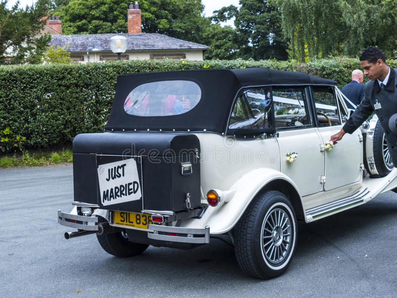 Wedding car at St Mary's Parish Church in Nether Alderley Cheshire. royalty free stock photos