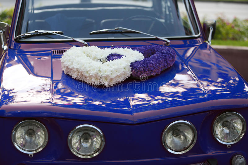 Wedding car. Two flower hearts on the top of an old vintage car, wedding day stock photos