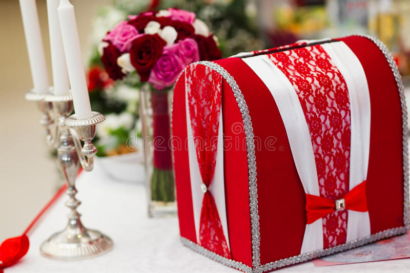 Wedding card box. A red card box, for putting envelopes into during a wedding stock photo