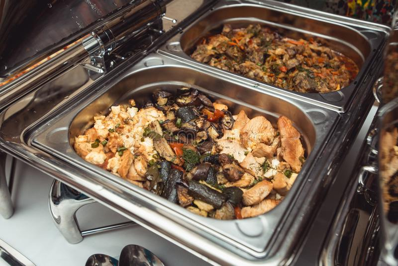 Wedding Catering: Chicken with Vegetables and Gravy in a steel Chafing Dish.  royalty free stock photo