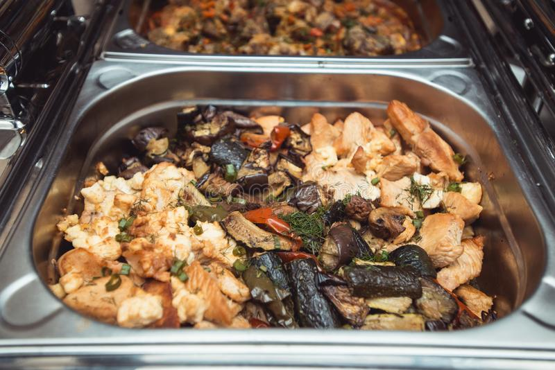 Wedding Catering: Chicken with Vegetables and Gravy in a steel Chafing Dish.  stock photo