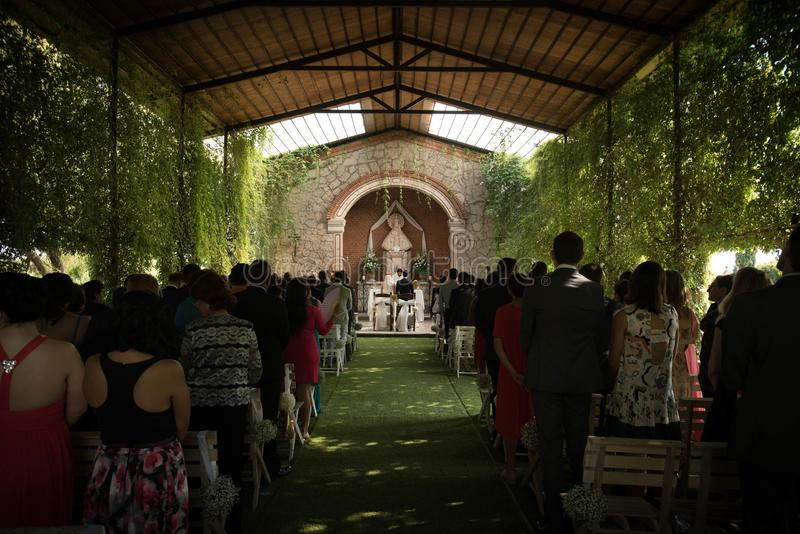Wedding in a Catholic church, outdoor ceremony in a garden chapel. Garden wedding church in Mexican hacienda, little outdoor chapel to celebrate outdoor royalty free stock photography
