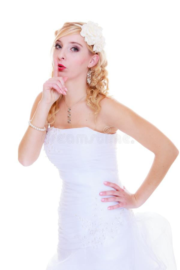 Bride in white wedding dress showing silence sign stock image