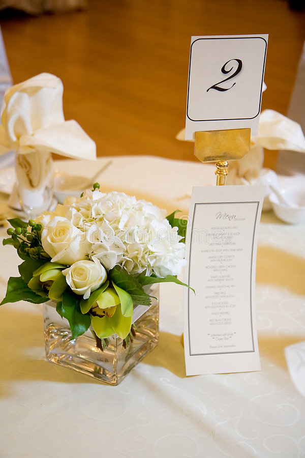 Wedding Centerpiece and Menu. Wedding centerpiece with banquet menu royalty free stock photo