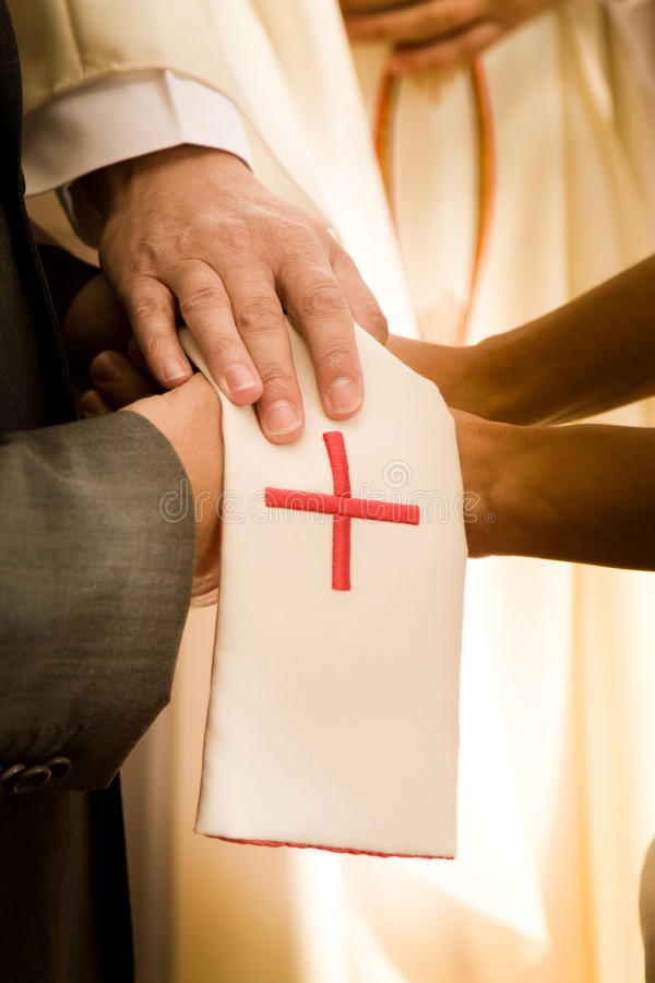 Wedding ceremony. A wedding ceremony with the blessing cloth royalty free stock image