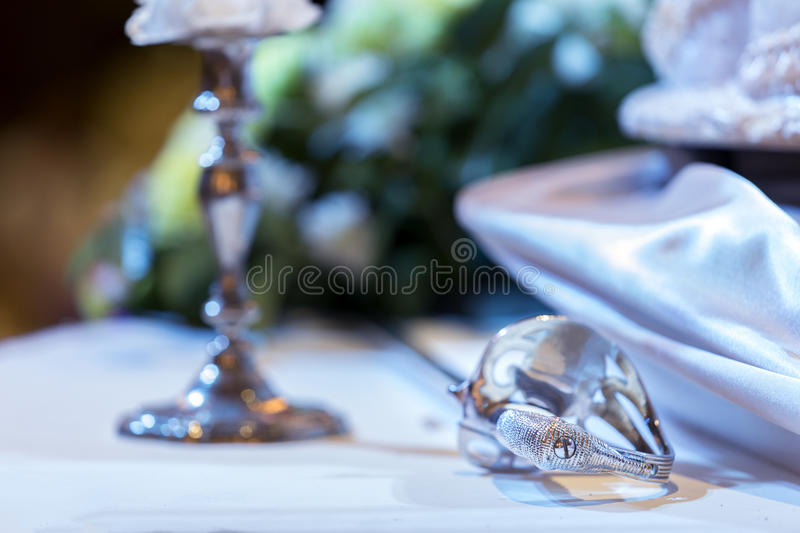 Wedding ceremony accessories tool, Candlestick with saber for cu. T wedding cake. - (Selective focus royalty free stock image
