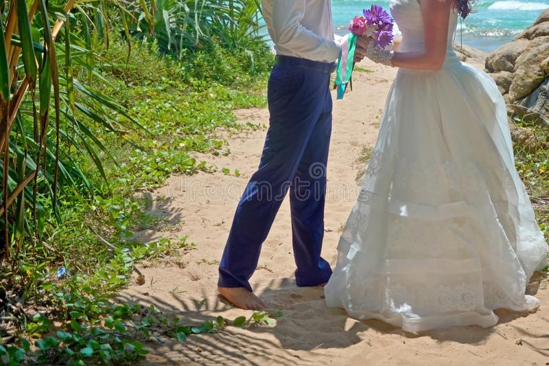 Wedding ceremony on beach in tropical palm tree, wedding and honeymoon. Beautiful bride and groom in the tropics on the island of stock photos
