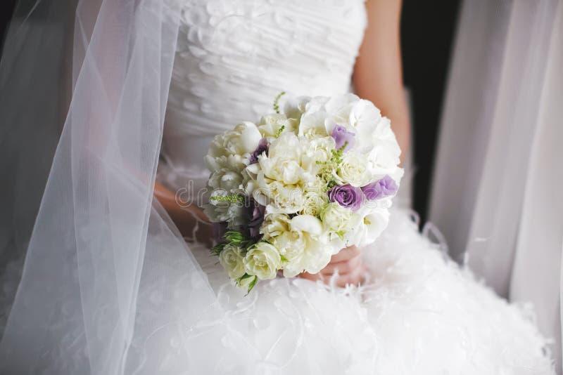 The wedding ceremony, bride holding wedding flowers royalty free stock images