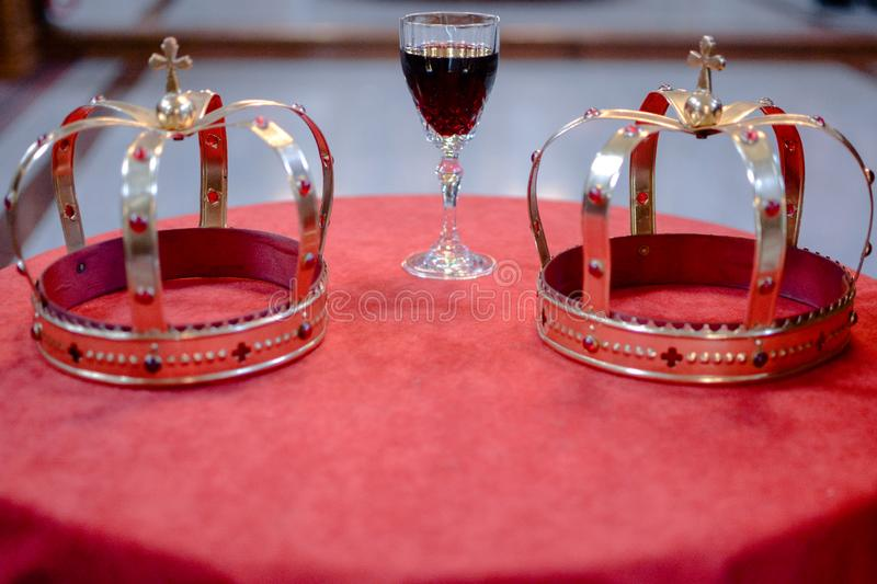Wedding crowns in Church. Wedding ceremony, crowns and vine stock images