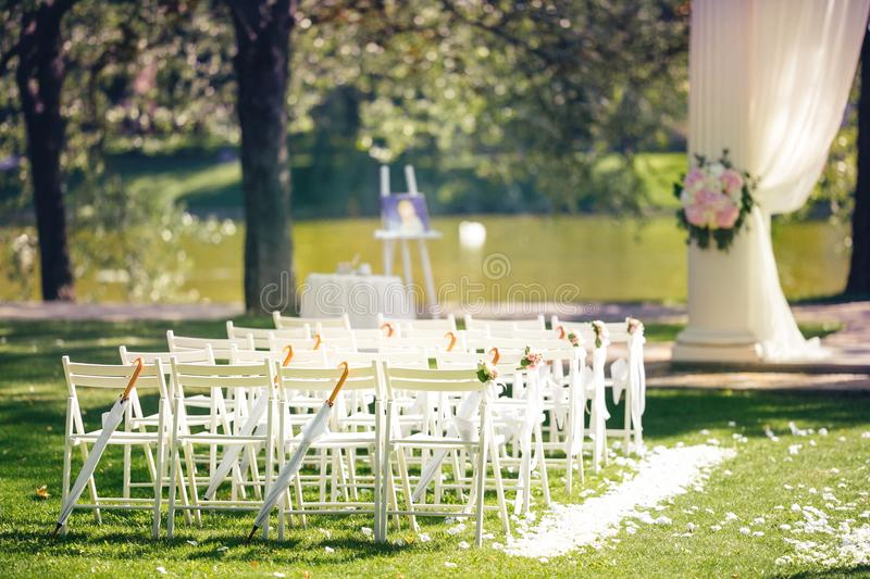 Wedding ceremony decoration with chairs and arch near the lake download wedding ceremony decoration with chairs and arch near the lake outdoor wedding ceremony at junglespirit Image collections