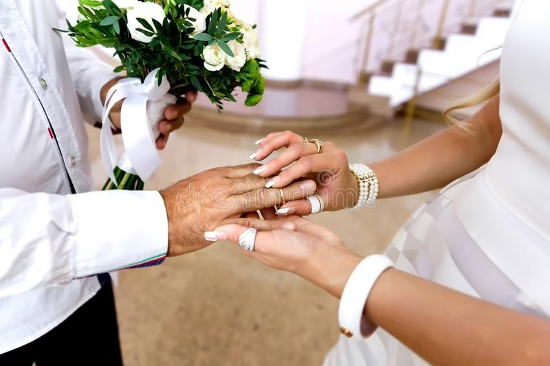 Wedding ceremony of dressing rings during the wedding, the painting of the bride and groom stock photography