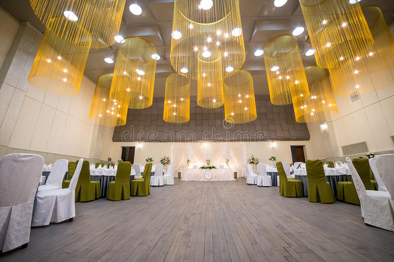 Wedding ceremony hall ready for guests,Luxury, elegant wedding r. Eception table arrangement,Indoors wedding reception venue with decor,Beautiful wedding stock photo