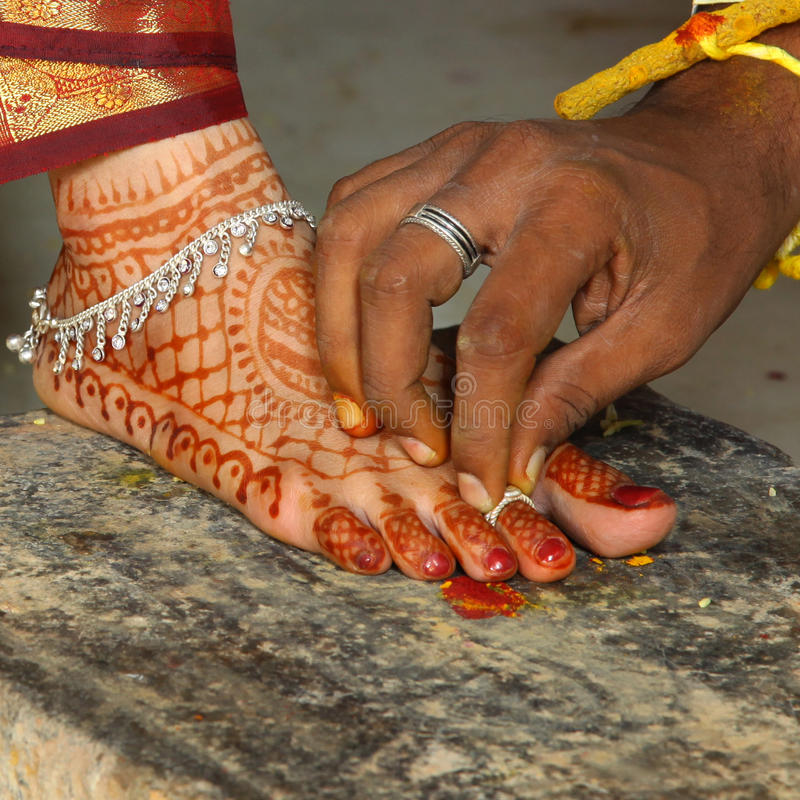 Wedding ceremony. Male groom holding Foot ring in Hindu Indian wedding ceremony