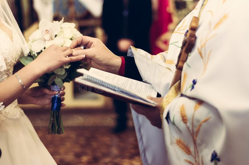 Wedding ceremony of wedding rings on a finger stock photography
