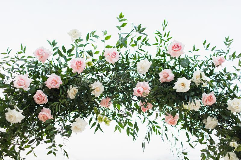 Wedding ceremony with roses in pink pastel color. Wedding ceremony arch arrangement decoration. Greens and roses in pink pastel color. Isolated on white royalty free stock photos