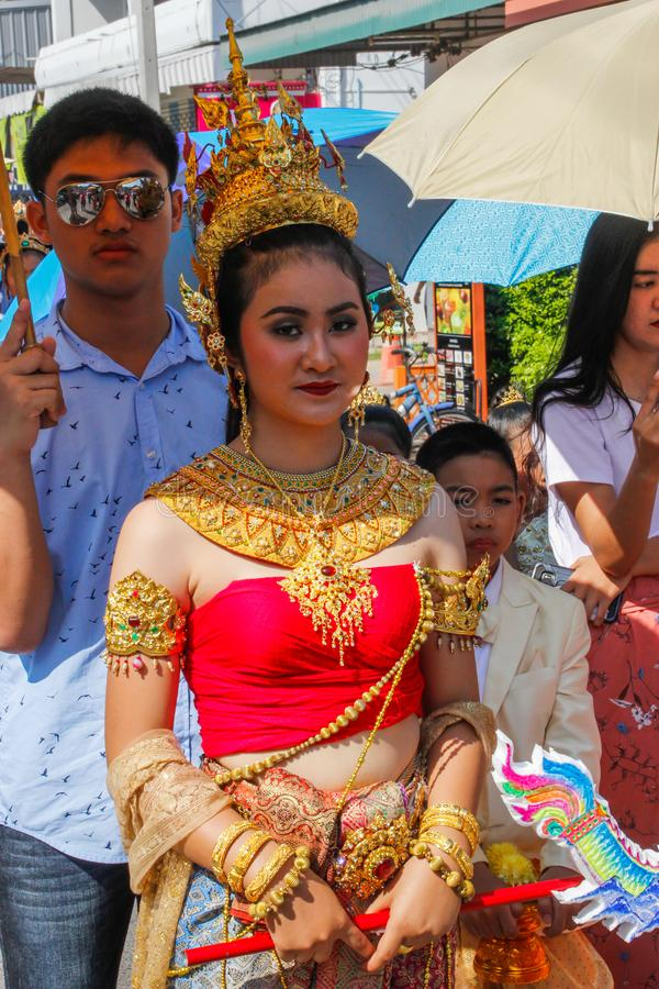 Wedding ceremony on the street. Young attractive Thai women in traditional dresses and jewelery are smiling cute stock photo