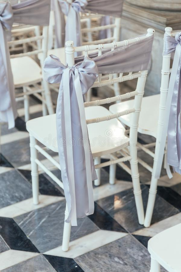 Wedding ceremony white seats for guests with fabric ribbon in Bangkok, Thailand royalty free stock photography