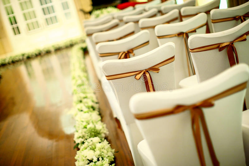 Wedding chair. Chairs and flowers at an indoor wedding royalty free stock photo