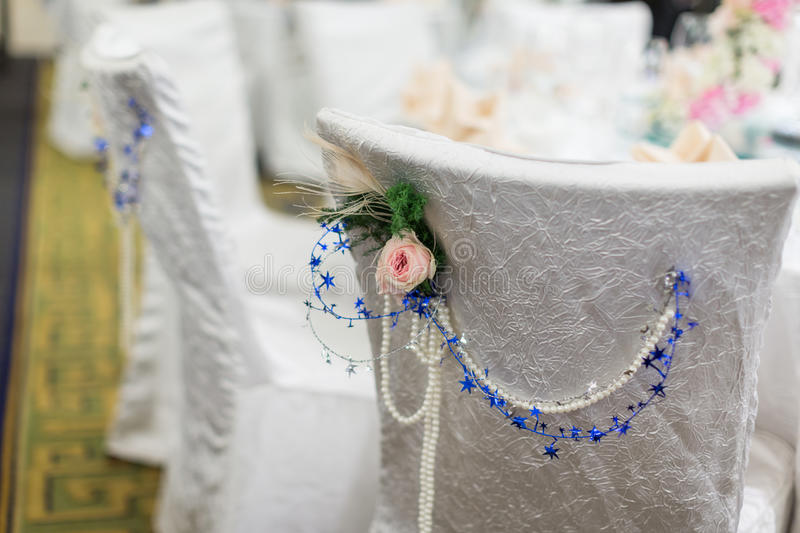 Wedding chair. S with flowers and blue decorations royalty free stock photography