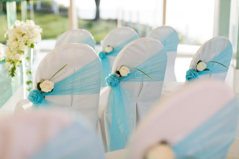 Wedding chair. S with flowers and blue ribbon royalty free stock photos