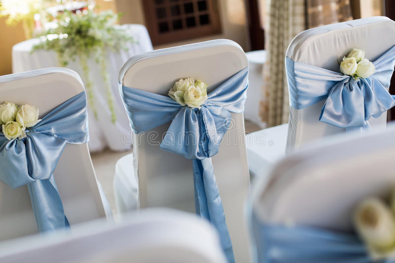 Wedding chair. S with flowers and blue ribbon royalty free stock images