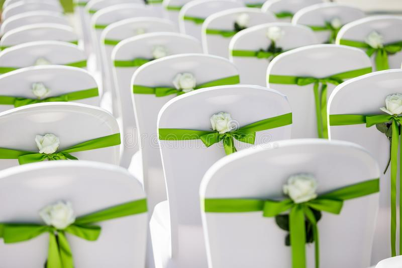 Wedding chair. S with flowers and green ribbon royalty free stock photos
