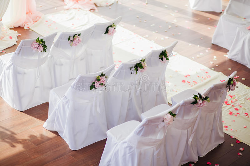Wedding chair covers with flowers. Wedding chair covers with pink flowers royalty free stock image