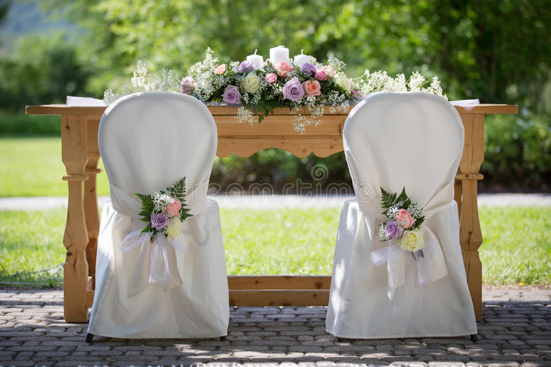 Wedding Chair Covers with Fresh Roses. Wedding Chairs Covers with Fresh Roses in a Wedding Day royalty free stock photo