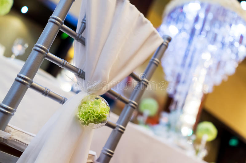 Wedding chair. With flowers at indoor wedding stock image