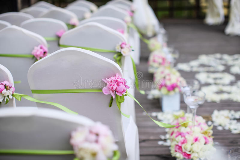 Wedding chairs. With green ribbon stock images